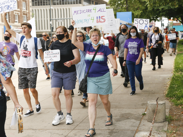 Supporters march July 24 at the Colorado State Capitol in Denver.